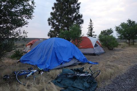 Tent with a big blue tarp