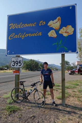 Me under the Welcome to California state sign