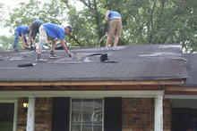 Tearing down the old roof