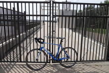 Bike in front of a locked gate