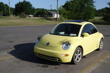 VW bug with eyelashes.