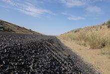 Roadside gravel and the sky