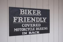 """Biker friendly - covered parking in back"""