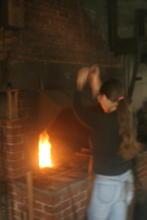 Helen hammers away at the bellows
